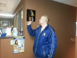 Bradley Kinkead rings a bell to signify his last chemotherapy treatment.